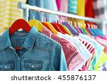 Stock photo children clothes hanging on hangers in the shop 455876137