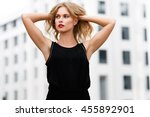 attractive blonde in black... | Shutterstock . vector #455892901