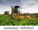 two combine harvesters harvest...