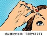 Woman Plucking Eyebrows...