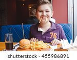 funny little boy eating a... | Shutterstock . vector #455986891