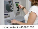 Woman Using Her Credit Card On...