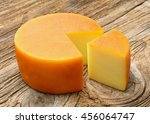 smoked cheese on wooden... | Shutterstock . vector #456064747