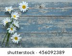Daisy Flowers On Old Wooden...