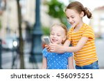 two cute little sisters playing ... | Shutterstock . vector #456095251