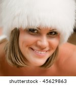 girl in fluffy white cap portrait - stock photo