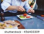 male cook serve delicious steak ... | Shutterstock . vector #456403309