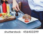 male cook serve delicious steak ...   Shutterstock . vector #456403399