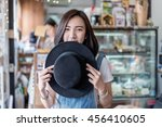 shy asian girl and black hat in ... | Shutterstock . vector #456410605