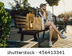 young beautiful woman sits on... | Shutterstock . vector #456413341