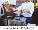 male cook preparing delicious... | Shutterstock . vector #456414577
