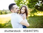 father and daughter resting... | Shutterstock . vector #456447391