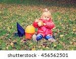 little girl trick or treating... | Shutterstock . vector #456562501
