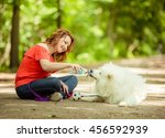 happy woman playing in the park ... | Shutterstock . vector #456592939