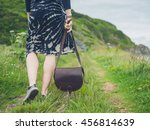 a young woman with a handbag is ... | Shutterstock . vector #456814639