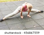 active young woman stretching... | Shutterstock . vector #456867559