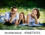 young beautiful family of three ... | Shutterstock . vector #456873151
