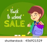 cute cartoon boy showing at... | Shutterstock .eps vector #456921529