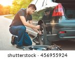 auto mechanic changing  tire on ... | Shutterstock . vector #456955924