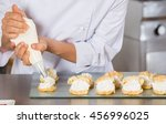 pastry chef decorating with a... | Shutterstock . vector #456996025