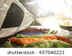 sleeping bags lined up in a... | Shutterstock . vector #457040221