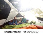 a bright shot of kids camping... | Shutterstock . vector #457040317