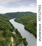 the river flows through the... | Shutterstock . vector #457127431