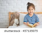 happy asian girl reading story... | Shutterstock . vector #457135075