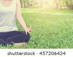 young woman doing yoga in the... | Shutterstock . vector #457206424