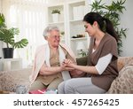 grandmother holding a hand of... | Shutterstock . vector #457265425