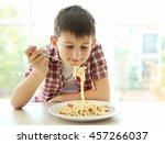 cute boy eating spaghetti on... | Shutterstock . vector #457266037