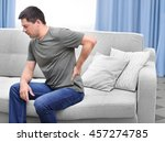 man suffering from back pain | Shutterstock . vector #457274785