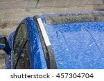 hail falls on a blue car roof. | Shutterstock . vector #457304704