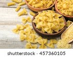 Dried Pasta On Wooden Board