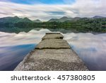 Stone Jetty With Reflections A...