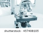 science microscope on lab bench.... | Shutterstock . vector #457408105