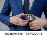 businessman solving cubic... | Shutterstock . vector #457420741
