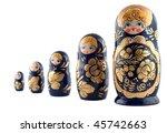 Russian matryoshka dolls in a row isolated on white - stock photo