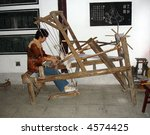 Ancient Chinese Loom being used in home factory in rural China - stock photo