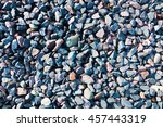 Small photo of Texture colored crushed gravel with admixture of river pebbles