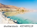 Stock photo dead sea coastline with white salt beach and mountains at sunny day in ein bokek israel white 457499119