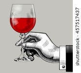 hand holding a glass with red... | Shutterstock .eps vector #457517437