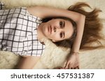 sensual woman lying on fur | Shutterstock . vector #457531387