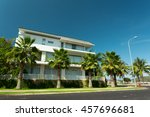 a white villa house surrounded... | Shutterstock . vector #457696681