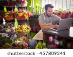 male florist using laptop at... | Shutterstock . vector #457809241
