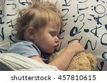 toddler sleeping with teddy bear | Shutterstock . vector #457810615