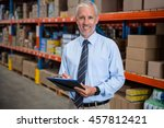 worker holding clibpoard in a... | Shutterstock . vector #457812421