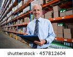 worker holding clibpoard in a...   Shutterstock . vector #457812604