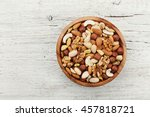 Wooden Bowl With Mixed Nuts On...