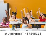 smiling school kids raising... | Shutterstock . vector #457845115